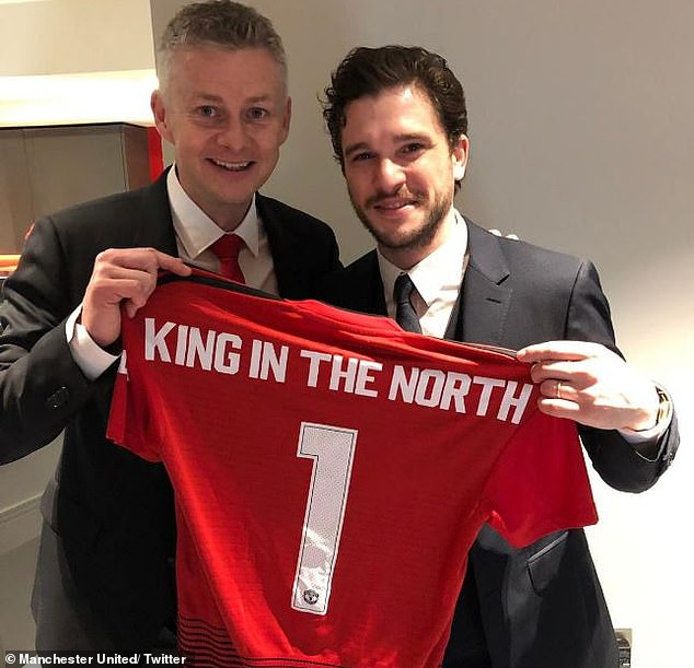Ole Gunnar Solskjaer held up a 'King in the North' Manchester United shirt with Harrington