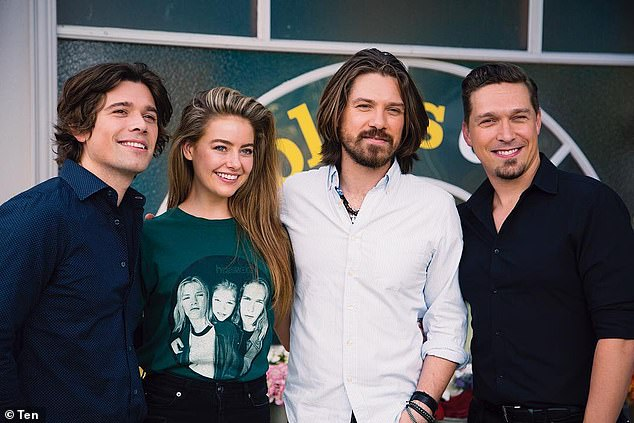'Fangirling hard!' Jodi Anasta and April Rose Pengilly (centre) share behind the scenes footage as pop stars Hanson (pictured) join the cast of Neighbours