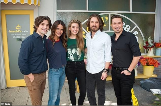 So excited! April Rose Pengilly (centre) and Jodi Anasta (second from left) shared several videos and photos of the band on the Neighbours set at Nunawading Studios in Melbourne