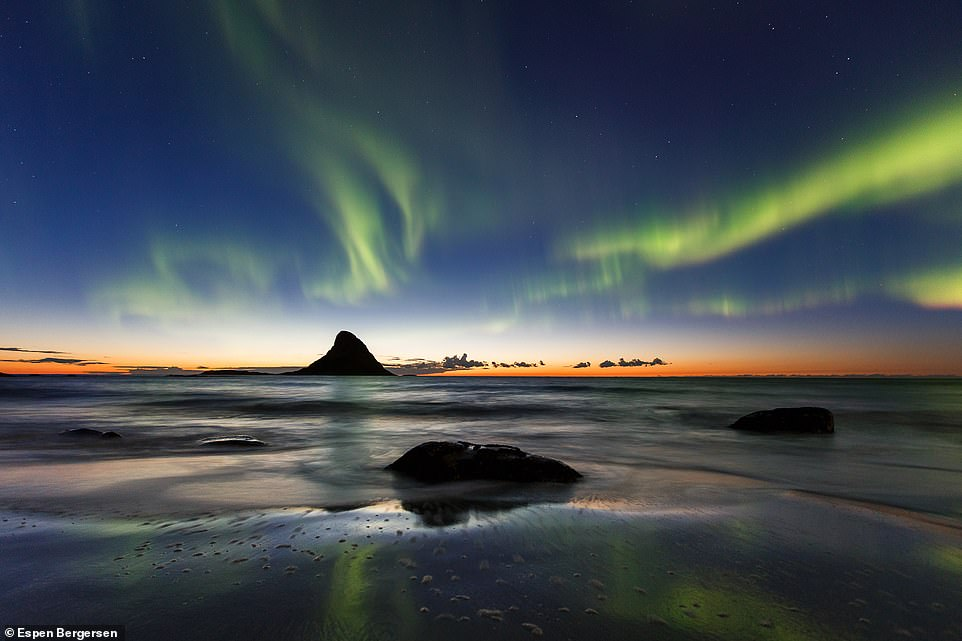 Espen says of this photo, taken on the island of Andøya in Norway: 'If you are lucky, you might photograph the Aurora when you still have some orange light from the sunset'