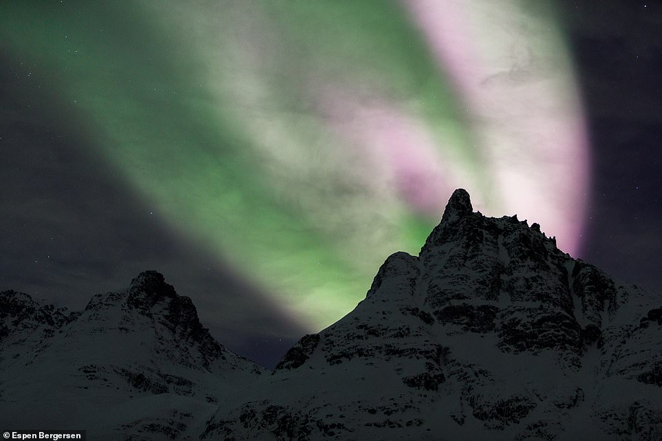 The northern lights look particularly bright in this striking image, taken on the mountain of Piggtinden in Troms
