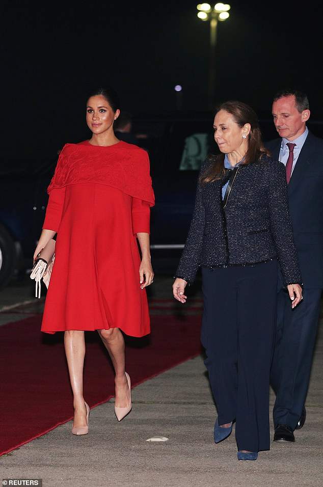 Mr. Reilly, far right, was the first to welcome Harry and Meghan, left, to the north African country on Saturday evening as they stepped off the plane at Casablanca airport