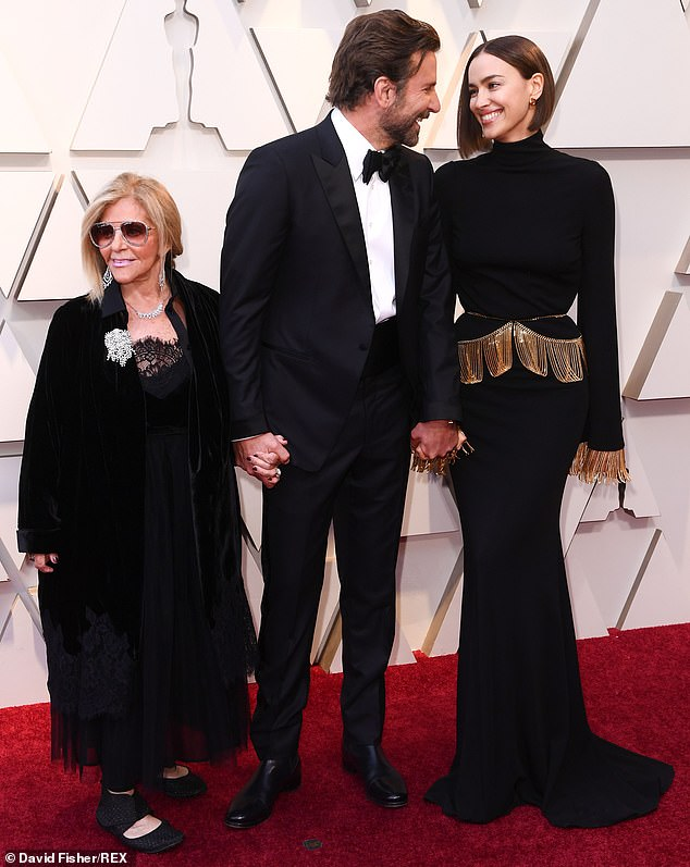 The source added: 'As for Irina she was sat down with Bradley's mom Gloria. If you didn't know any better you wouldn't have known she was at the party with Bradley, they didn't seem to interact at all.' Pictured: Bradley, 44, arriving  with  Irina and his mother, Gloria Campano