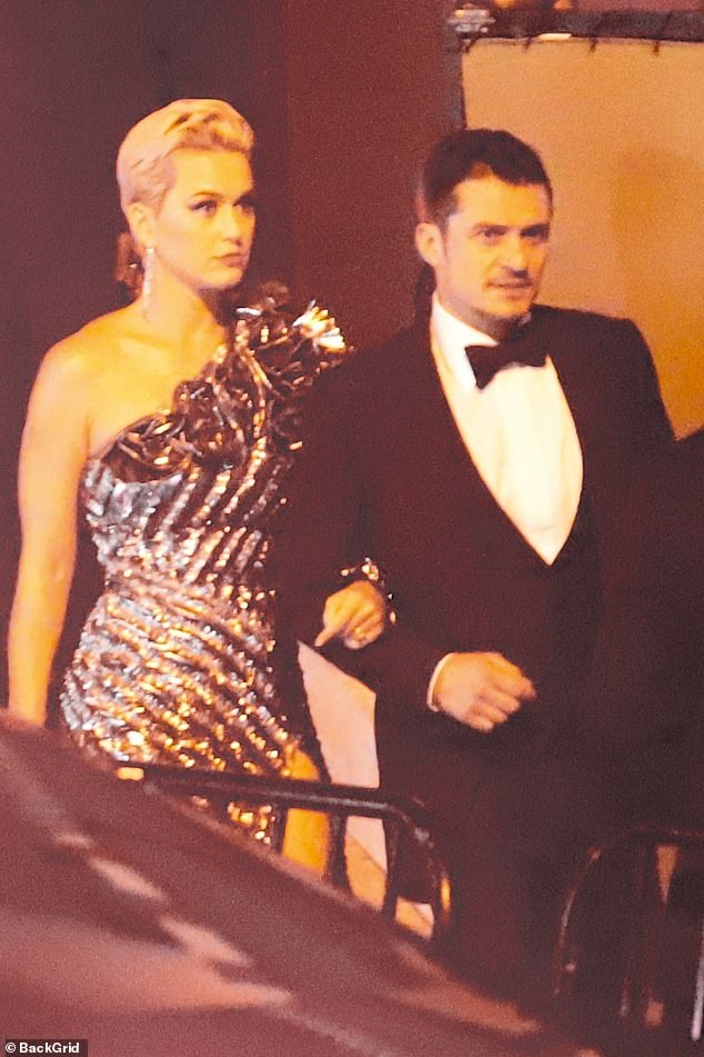 Glitter girl:Katy Perry and fiance Orlando Bloom looked elegant as they arrived at Jay Z and Beyonce's reportedly secret Oscar bash in West Hollywood on Sunday