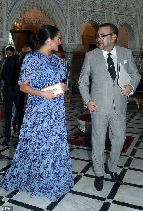 The Duchess is all smiles as she speaks to Morocco's King Mohammed VI