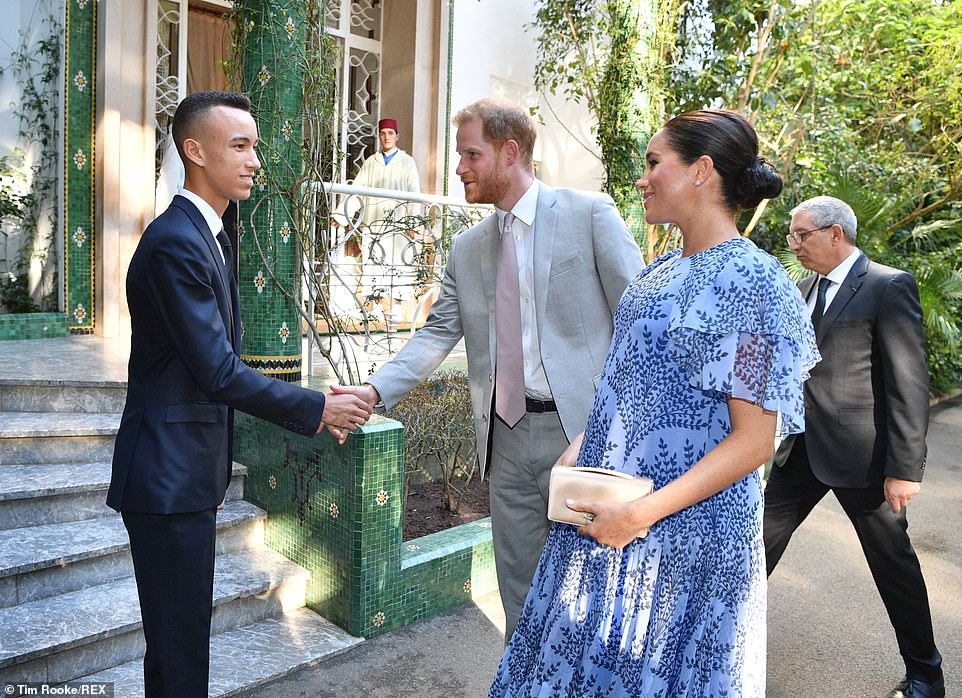 Harry and Meghan are all smiles as they are greeted by Morocco's Crown Prince Moulay Hassan this evening.The royal couple, who are on a three-day tour of the North African country, spent last night with the country's British Ambassador