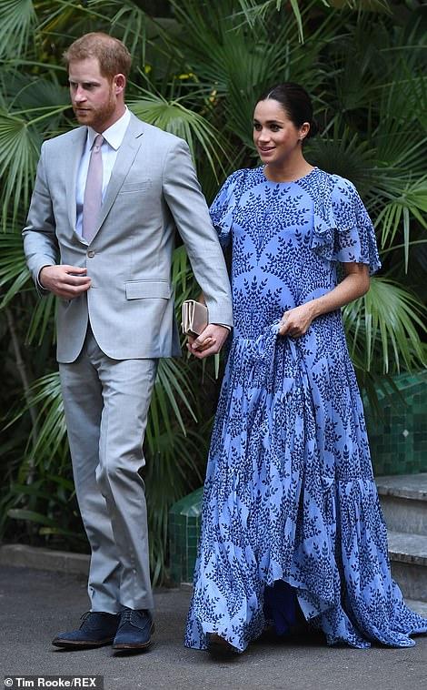Meghan, who put on a tactile display with her husband, was wearing a dress by Venezuelan designer Carolina Herrera