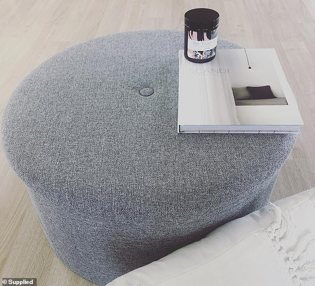 Claire, who is the founder of the Instagram page The KmartLover, shared a photo of how she'd styled the Kmart ottoman (pictured)