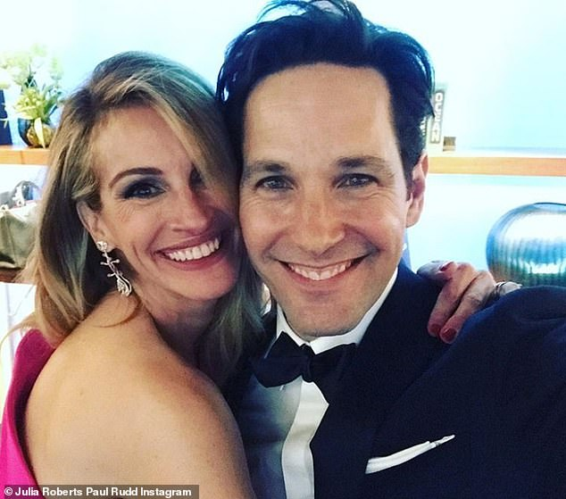 Forever young: Rudd struck a pose with Julia Roberts at the star-studded awards show