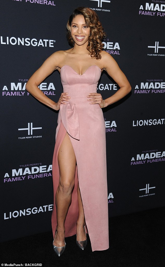 Dared to bare: The actress, 33, showed up in a strapless pink blush dress and shiny silver heels with the side slit showing off her shapely legs