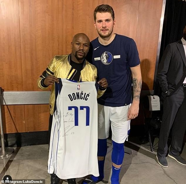 761f345004a Luka Doncic (right) poses with Floyd Mayweather after signing his jersey  for the retired