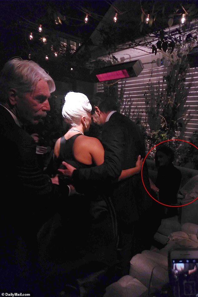 Nothing to hide: Later on in the night, Bradley and Gaga continued to look close while his girlfriend Irina sat close by on a sofa