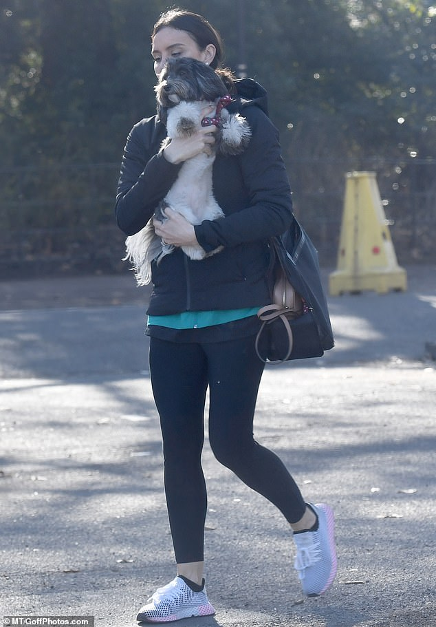 Puppy love: Christine Lampard made time for the other subject of her affection as she lavished her pet pooch with hugs while enjoying a stroll in her local London park on Monday morning