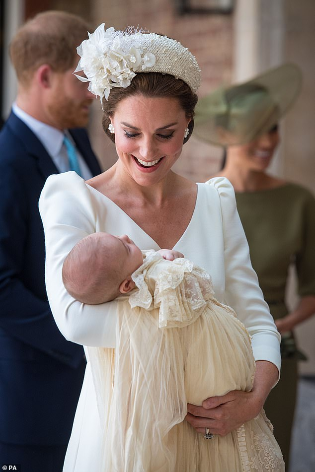 The Duchess of Cambridge smiling, holding Prince Louis during his christening on 9 July 2019. The official photographer for the event, Matt Holyoak, said everyone was 'relaxed and in great spirits'