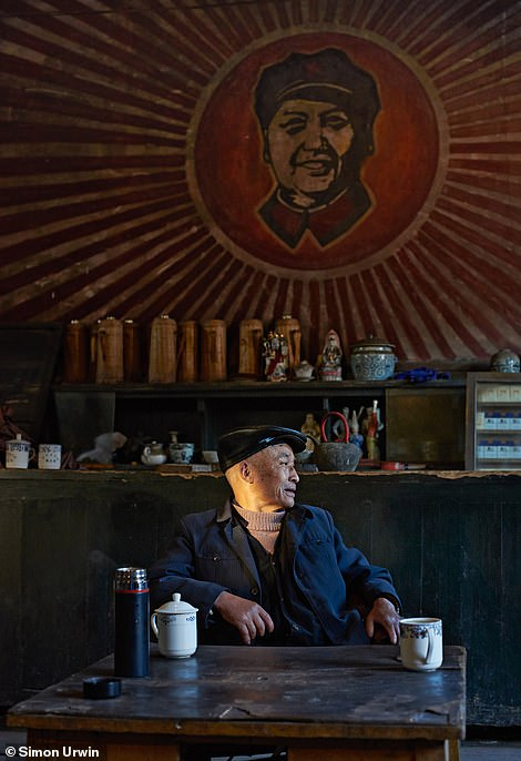 Urwin took a shot of original communist propaganda hanging on the wall of a building in the town of Pengzhen, China. He says the artwork 'features Chairman Mao's trademark beneficent smile'