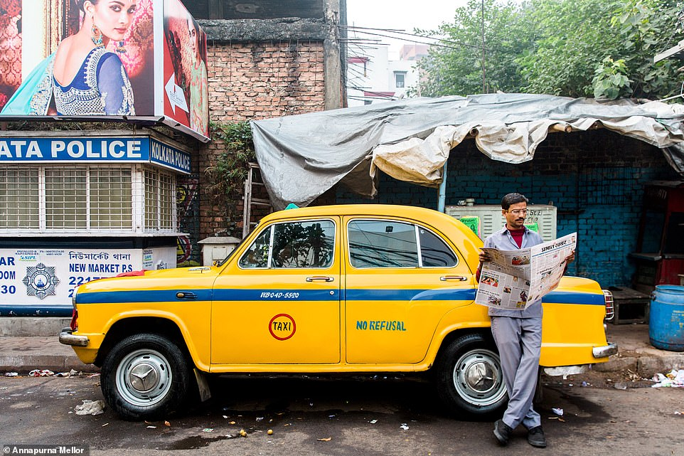 Annapurna Mellor took this colourful photo in the streets of Kolkata in India. The image, which shows a taxi driver leaning against his yellow cab reading a newspaper before starting his day, came first place in the 'cities' category
