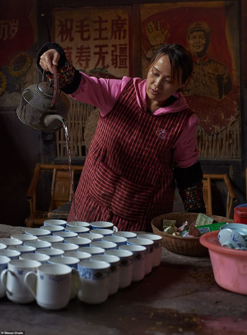 This photo by Urwin shows a female server in a local teahouse pouring water from a height to 'extract maximum flavour'. Apparently she was serving a refreshing blend of jasmine and green tea