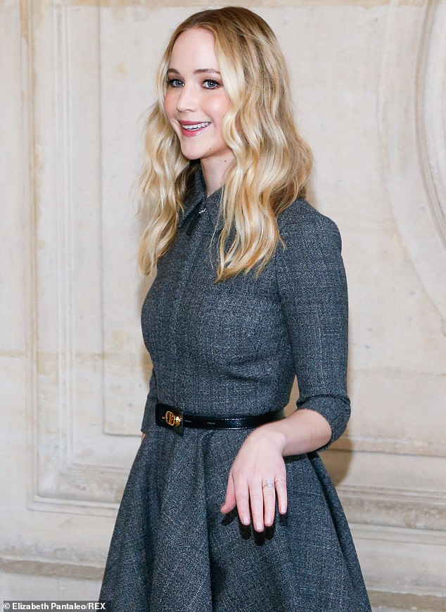 Lucky lady! Jennifer Lawrence proudly displayed her huge ring as she arrived at the Dior autumn-winter Paris Fashion Week presentation at Musée Rodin on Tuesday afternoon