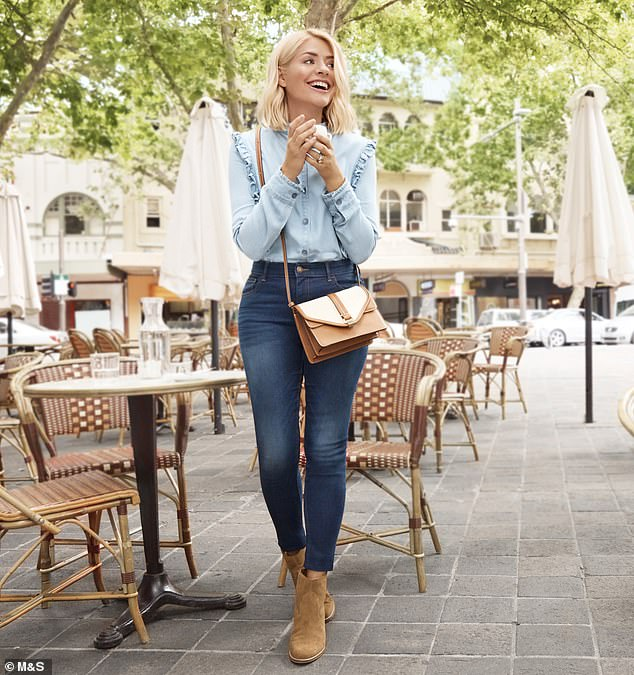 The £32.50 denim ruffle shirt, pictured, is also sold out in almost every size online. Also pictured: skinny jeans, £19.50; cross body bag, £29.50; suede ankle boots, £49.50
