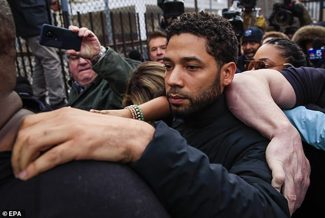 Jussie Smollett, pictured leaving county jail last week, maintains he is innocent and claims he was attacked by homophobic, racist assailants who shouted: 'This is MAGA country!'