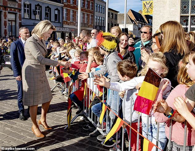 The royal looks ecstatic to meet crowds of well-wishers, who greeted her with a sea of Belgian flagsduring a visit to Herentals, Antwerp on Tuesday