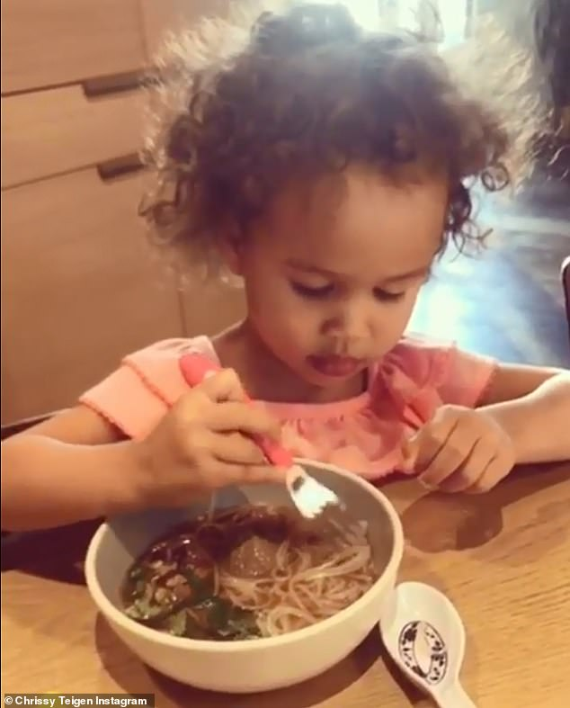 Good eats: Teigen shared a sweet video of the little girl slurping up glass noodles like a pro, as she boasted 'so proud' in the caption