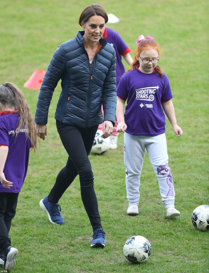 Out on the Windsor Park turf, the royals joined in some training exercises with local schoolchildren