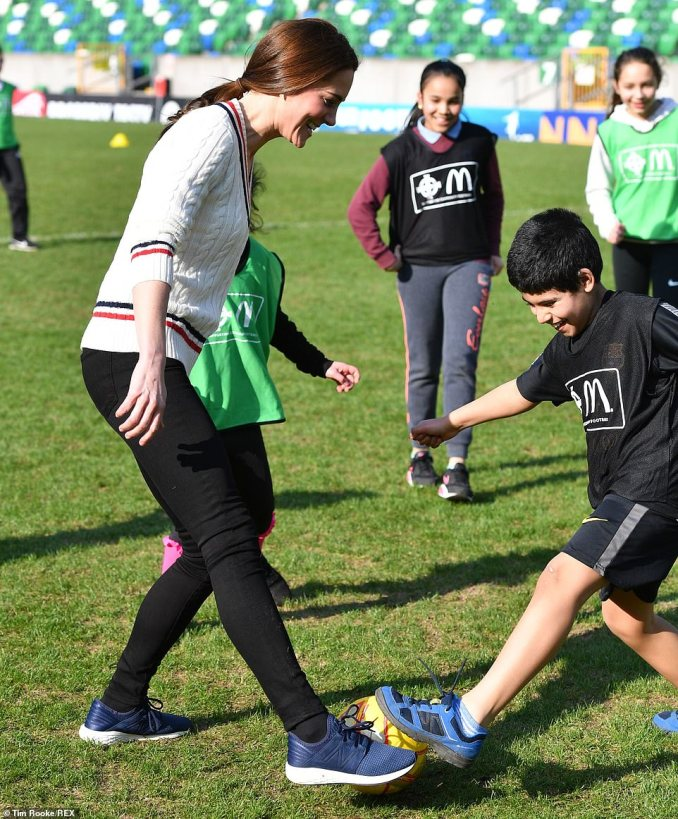 Sporty Kate appeared perfectly at ease as she played around with youngsters on the turf at Belfast's Windsor Park