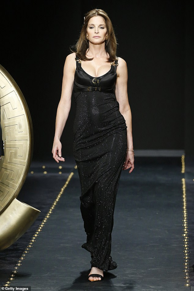 Stunning: Stephanie Seymour, 50, walks the runway at the Versace show at Milan Fashion Show