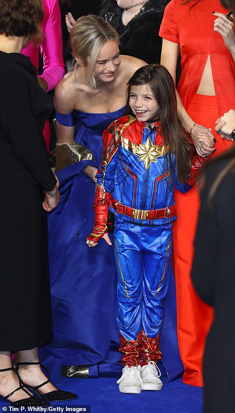 Cute: Brie was seen sweetly fussing over a young fan who came kitted out in her superhero costume