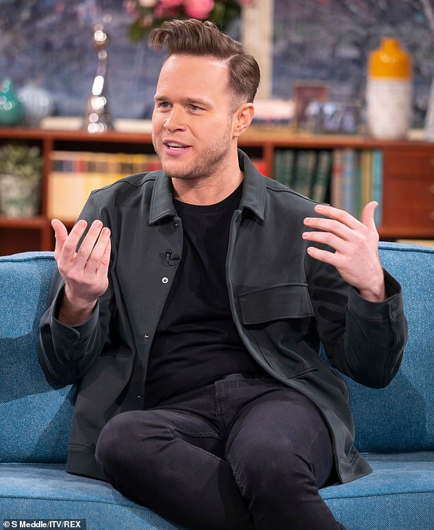 Candid: Olly Murs revealed Simon Cowell tried to persuade him to return to the X Factor... as the singer threw shade at show's format overhaul on Thursday's edition of This Morning