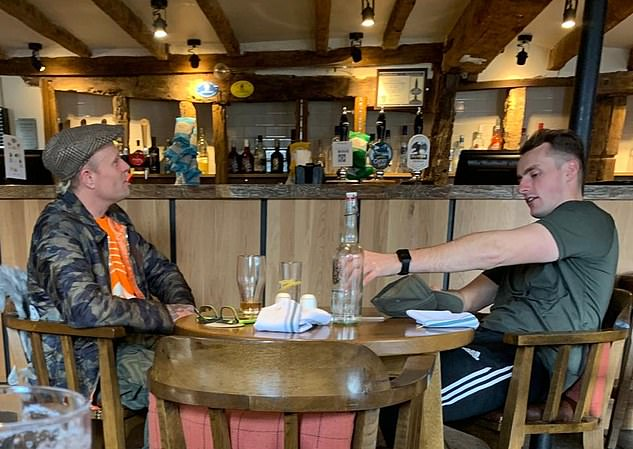 Flint (left) seemed happy on March 2 in Chelmsford, proudly discussing that morning's personal-best 5k run with his personal trainer (right) and how it felt good to open his lungs up