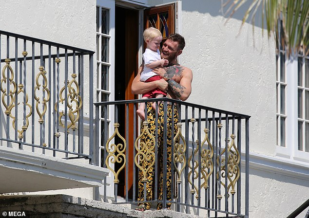 The MMA fighter brought out his son, Conor Jr, at the property of the fashion designer in Miami