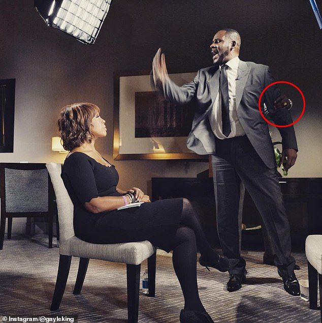 The singer needed to be restrained by his publicist at one point while King sat calmly in her chair