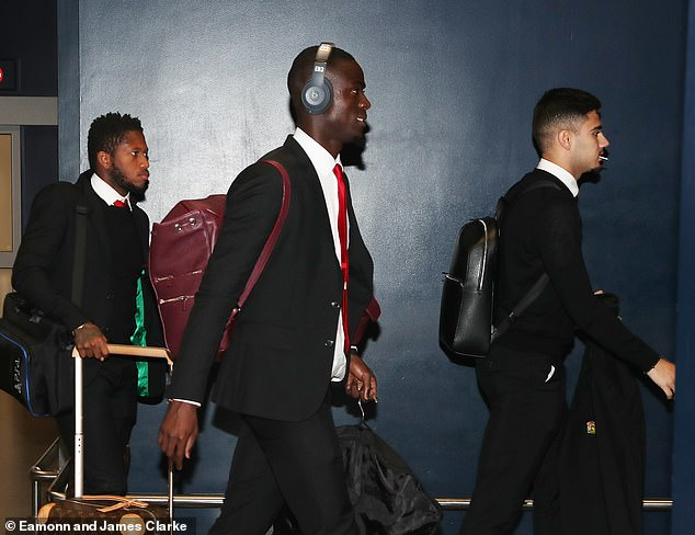 Fred (left), Eric Bailly and Pereira strolling through the airport on Thursday morning