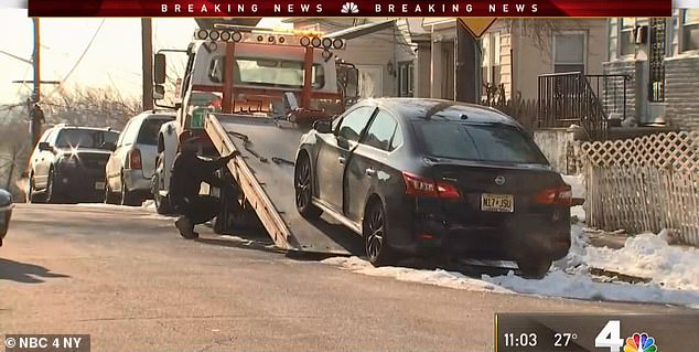 The car was towed from the scene and officers were canvassing the neighborhood