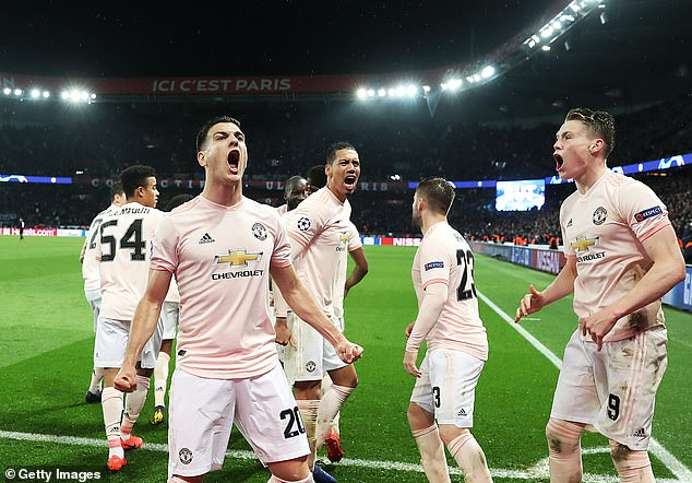 A Manchester United fan would have been stabbed in the chest by a taxi driver in Paris last night after the team's victory against the PSG (pictured, Manchester United players celebrated)