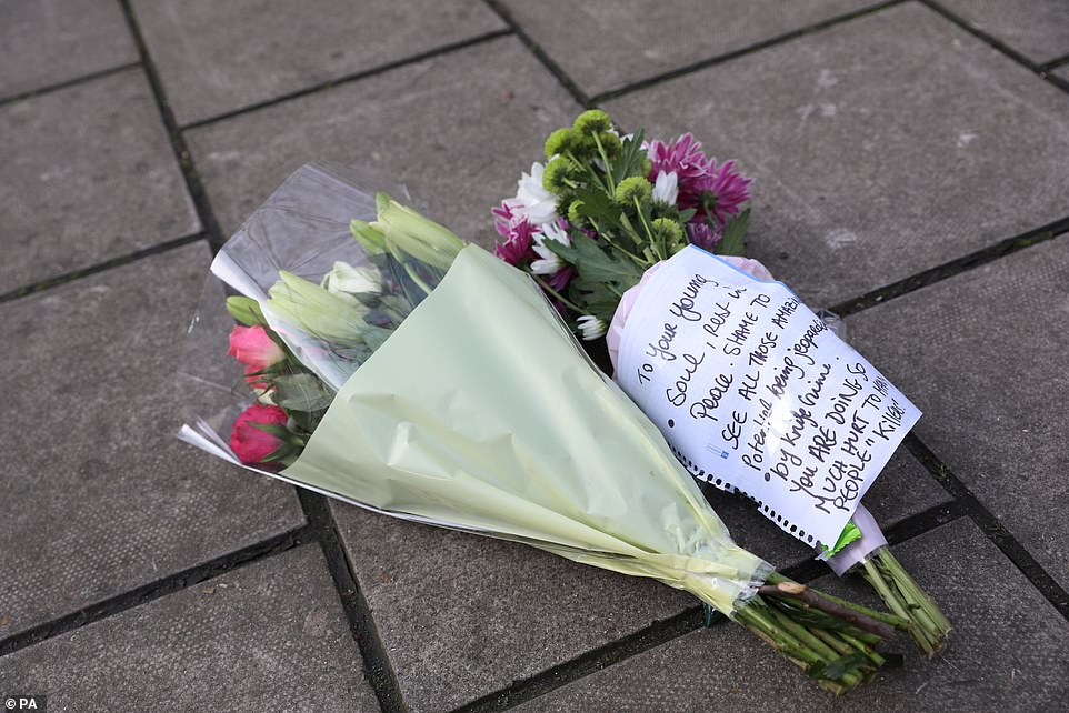 Flowers left in Lanfrey Place in West Kensington in memory of Mr Hassan, whose family called him 'a wonderful boy'