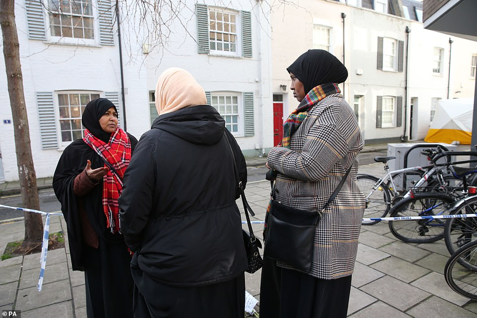 Woman pay their respects to Mr Hassan in West Kensington as yet another London community is hit by a fatal stabbing