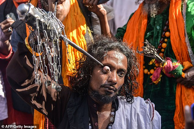 An Indian Muslim devotee performs a stunt by using a knife to bulge out his eyeball as he takes part in a religious procession for the annual Urs festival at the shrine of Sufi saint Khwaja Moinuddin Chishti in Ajmer, in the Indian state of Rajasthan