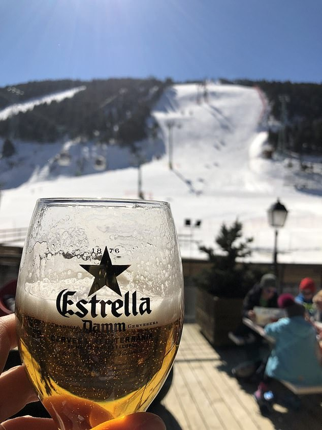 Enjoying a beer in the sunshine overlooking the Aliga slope, used for the speed races in the World Cup
