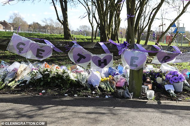 Masses of flowers and letters to Jodie have been displayed with the 'Get Her' being displayed in purple hearts