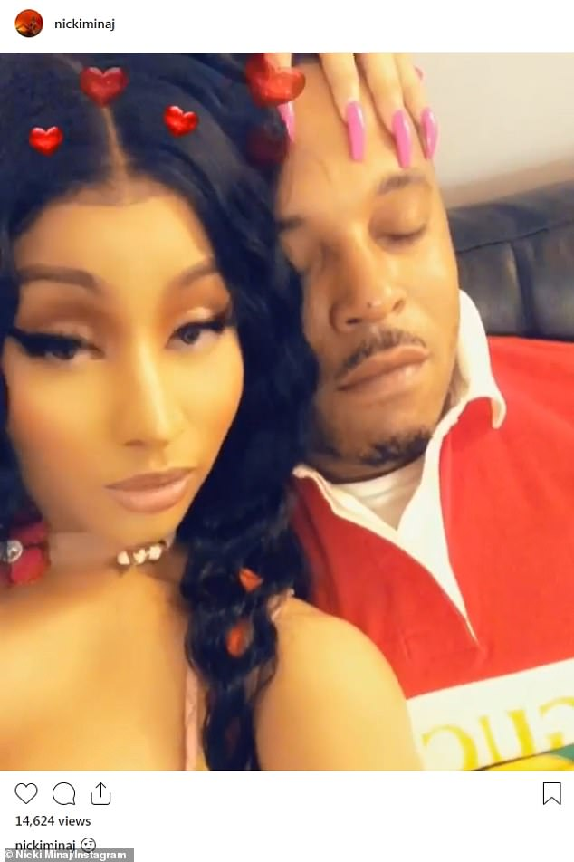 Controversial romance: Following the cancelled performance, Nicki posted a video to Instagram of her boyfriend, Kenneth Petty, 40, playing a carnival game; pictured together in February
