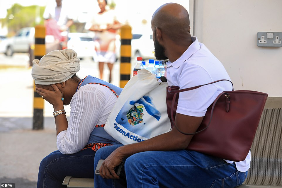 A Djiboutian national Hiba (L) is comforted by a relative as she waits for details of her loved one that was on board the flight Ethiopian Airlines Flight 302, at the Jomo Kenyatta International Airport (JKIA) in Nairobi