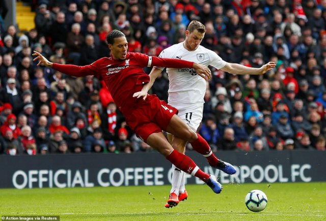 Liverpool defender Van Dijk reads a through ball well and cuts it out before Burnley striker Chris Wood can latch on to it