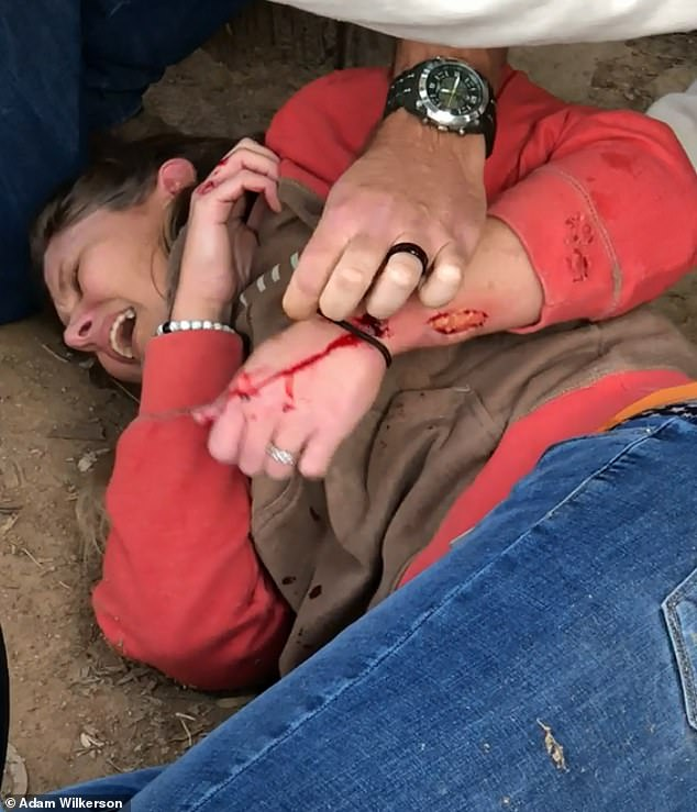Footage shot by a witness showed the woman lying on the floor crying in pain as she nursed her injured arm