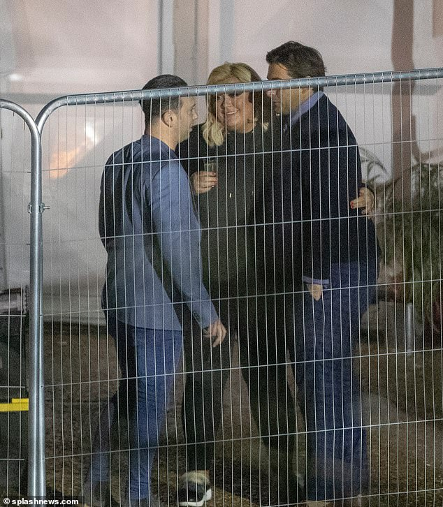 Three's no crowd: Gemma and Arg looked very loved up as they conversed with Neil