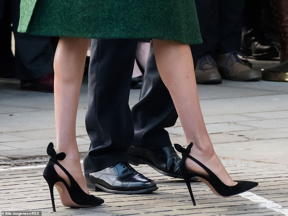 The Duchess of Sussex teamed her look with black accessories, holding a small clutch bag and£486 Aquazzura Deneuve pumps. She gave a nod to Canadian design by wearing a bottle green coat dress by Erdem