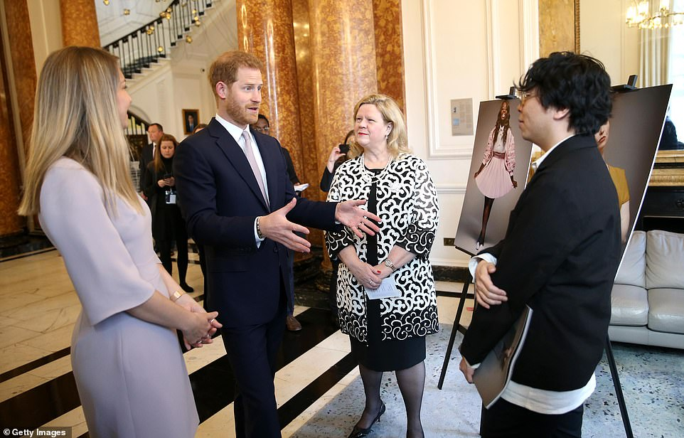 Harry speaks withCanadian High Commissioner to the United Kingdom Janice Charette (second right) as he and Meghan attend a Commonwealth Day Youth Event at Canada House this morning