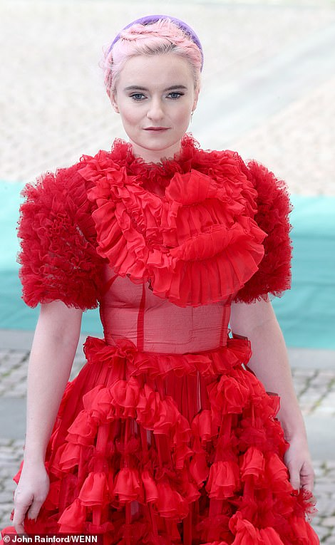 Grace Chatto, the cellist for Clean Bandit arrived wearing a frilly red dress. She will perform with the rest of the band during the service later today